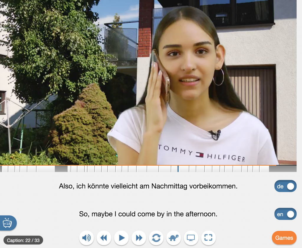 Yabla interface with two sets of subtitles, one in German and one in English